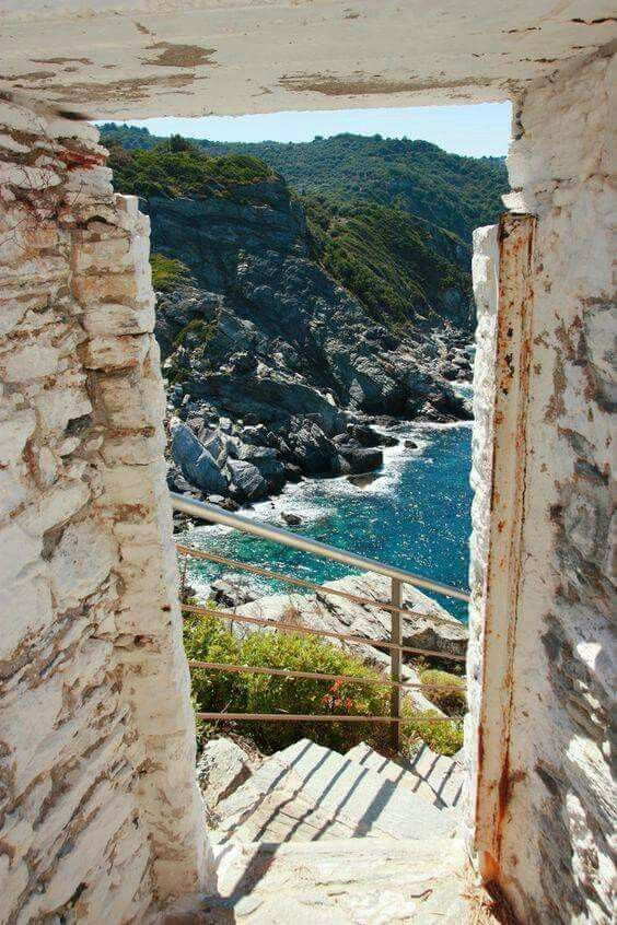 """Climbing the steps to the chapel of Agios Ioannis Prodromos in Skopelos island, (the wedding chapel at the """"Mamma Mia"""" movie)."""