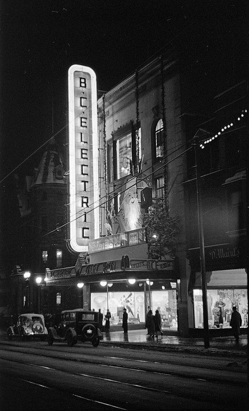 [The B.C. Electric store on Granville Street decorated for Christmas and illuminated at night] ca.1937 | by City of Vancouver Archives