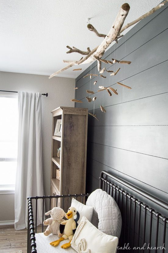 Beautiful and easy for a coastal nursery! DIY driftwood mobile at www.tableandhearth.com