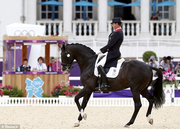 Carl Hester part of Team GB's Dressage team take  gold medal