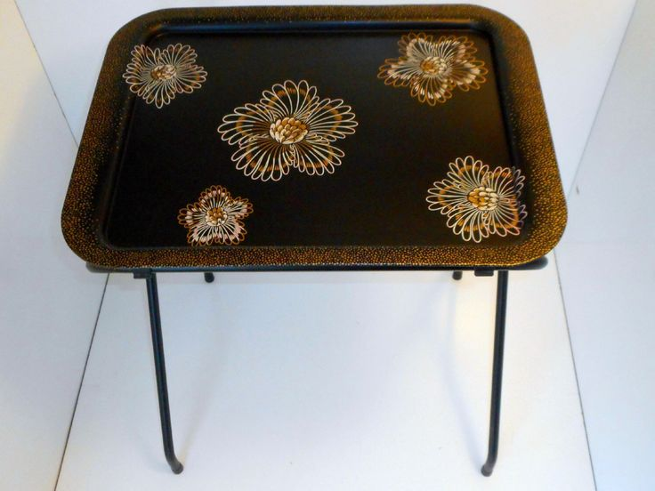 Vintage Tv Trays set of 4 1950s Metal TV trays with stand Pink Black Gold by nanascottagehouse on Etsy https://www.etsy.com/listing/219605290/vintage-tv-trays-set-of-4-1950s-metal-tv