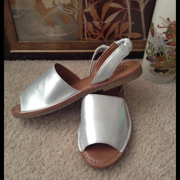 ️️️️️️Reduced Silver Flat Sandals Attractive new silver flat Sandals .Nice for any occasion. Silver is the new trend in  shoes.  NWOT.   No trades. No PayPal. Yes to bundles Yes to offers SO Shoes Sandals