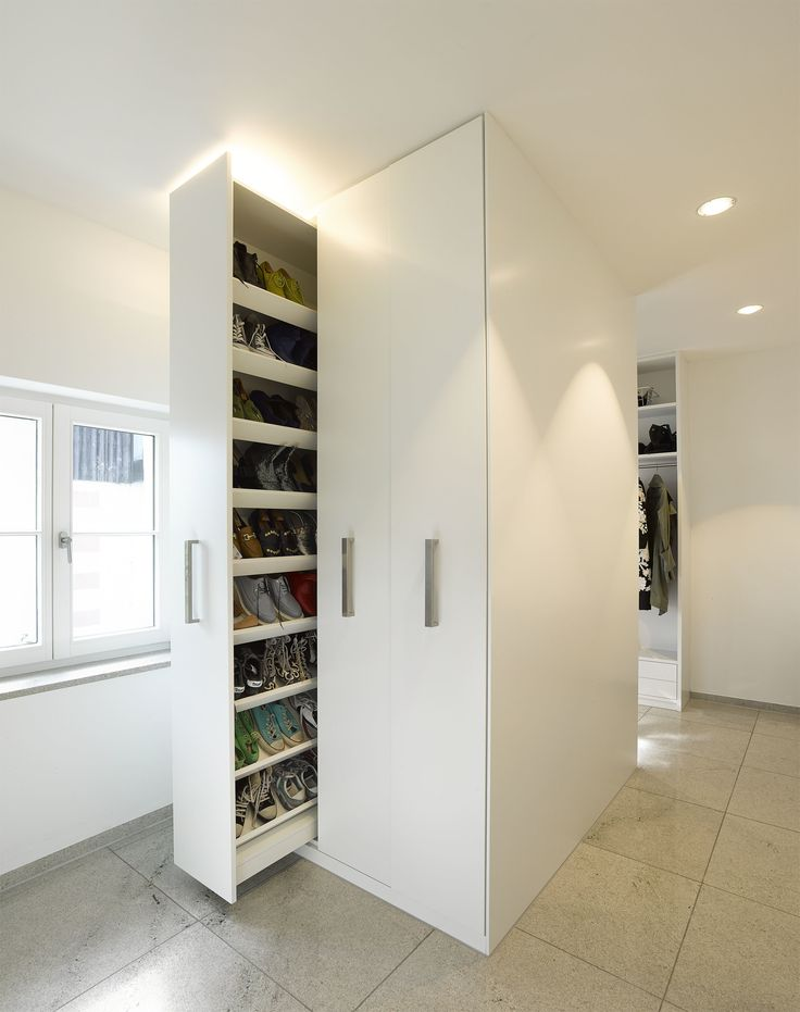 Though the home is expansive, the team made certain to waste as little space as possible. Clever moments of storage, like this sliding shoe closet, abound.