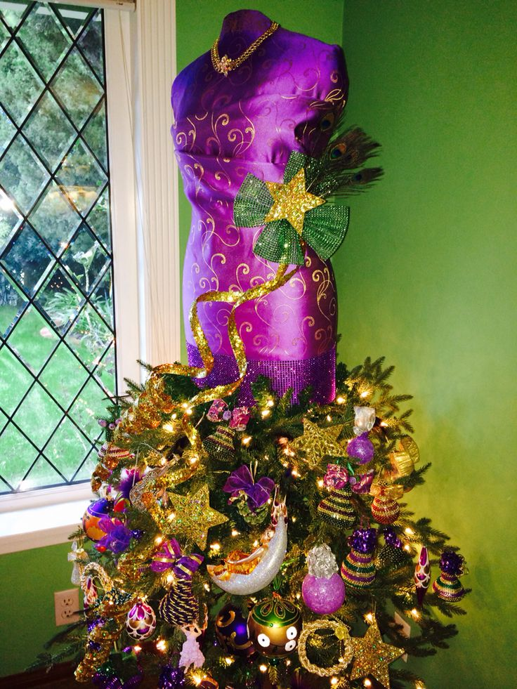 Christmas tree dress form using the centre section of artificial tree with lights attached