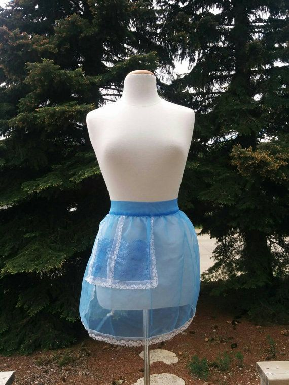 Check out this item in my Etsy shop https://www.etsy.com/listing/294964167/vintage-sheer-lacey-baby-blue-apron-with