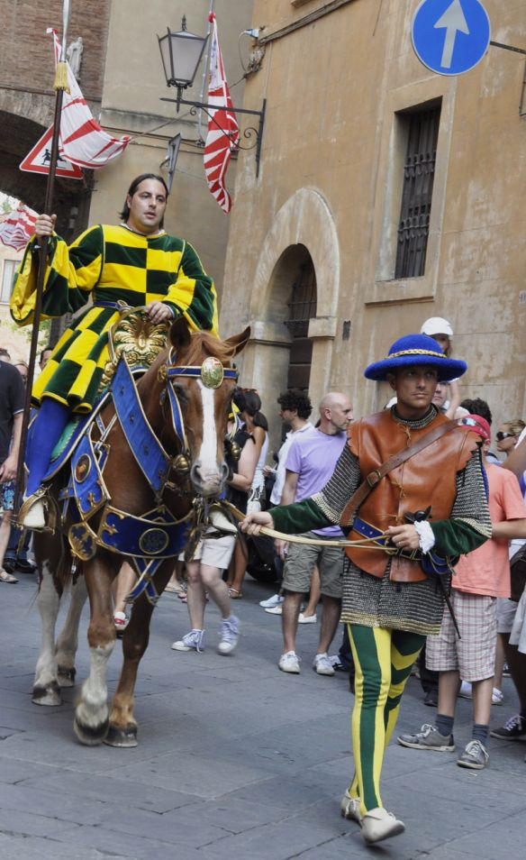 a procession through the street by the Bruco contrada