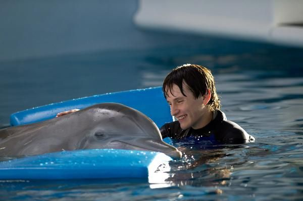 Winter the beautiful dolphin and Nathan Gamble as Sawyer ...