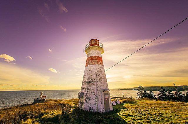 Sugar-plum coloured skies… | photo by @threecows #explorenb . . . #musquashhead #newbrunswick #nouveaubrunswick #explorecanada #canada #lighthouse #bayoffundy #ocean #skyporn #purple #green #coast