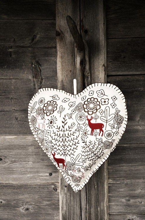 Embroidery on this heart. Love the touches of red.