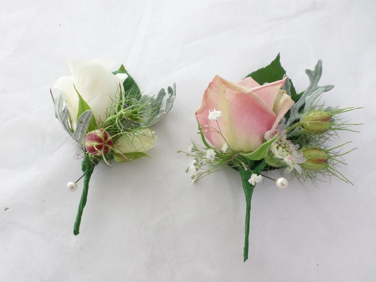 Wedding buttonhole made with Roses and Dusty Miller created by florist ilene http://www.floristilene.co.nz/