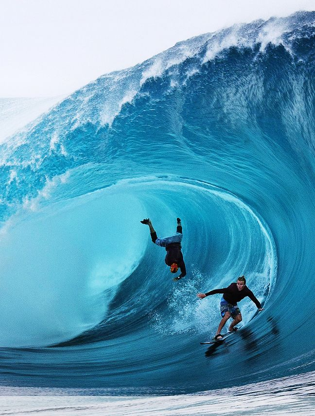Surfers Garrett McNamara (left) and Mark Healey of the U.S. compete during a free session of surf tow in, in the southern Pacific ocean island of Tahiti, French Polynesia, on June 1, 2013 in Teahupoo. (Gregory Boissy/AFP/Getty Images) | #TeeVogue #inspire #surfing