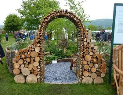 Unique arbor from stacked firewood....