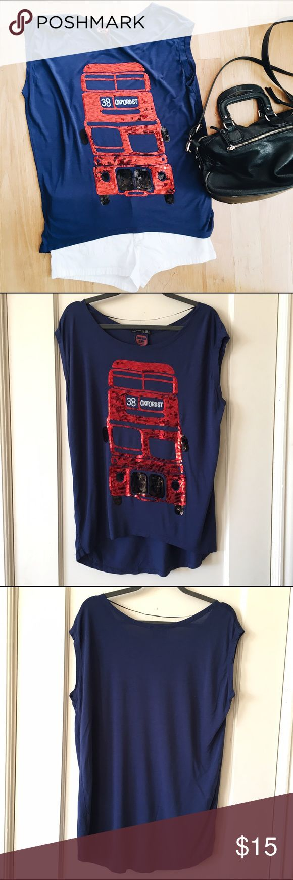 Primark Top with Sequin Double Decker Bus Gently worn dark blue top by Primark or their brand Atmosphere. It has an iconic double decker bus in red sequins. It was bought in the Flagship store in London on Oxford Street. Size US 6 UK 10 Primark Tops Tunics