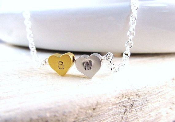 I think this is sweet :)    Tiny Heart Necklace Two Hearts with Hand Stamped by IrinSkye, $24.00