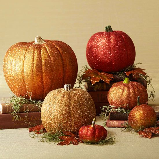 Get glam pumpkins this Halloween using craft glue and glitter. Find out how here: http://www.bhg.com/halloween/outdoor-decorations/spooky-home-decorations/?socsrc=bhgpin090612glitterpumpkins#page=3