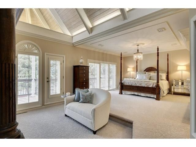 Spa like master bedroom suite design with sitting area for Walk in fireplace designs