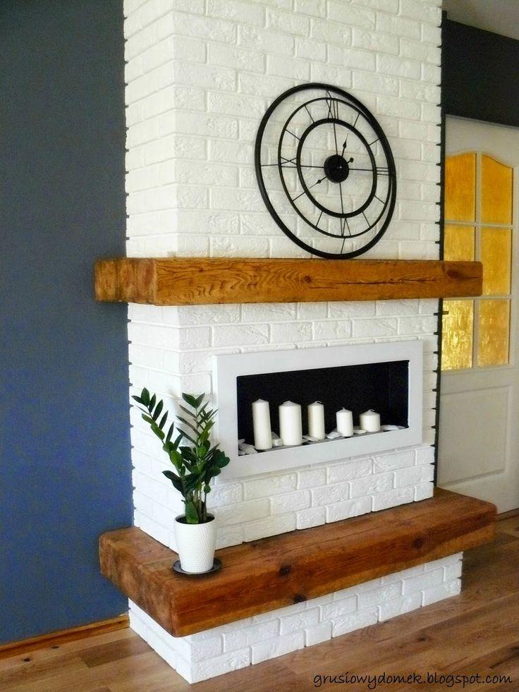 Bio- kominek z białej cegły z drewnianymi belami