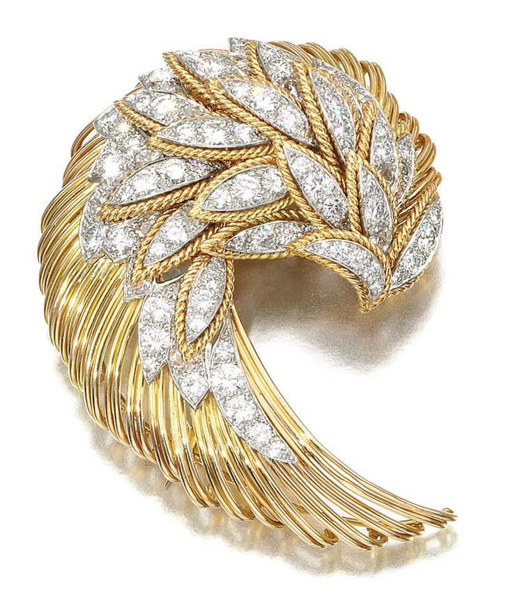 DIAMOND BROOCH, CARTIER, CIRCA 1960.  Designed as a stylised wing, set with brilliant-cut diamonds, signed Cartier, made in France and numbered, French assay and British import marks for London 1960.