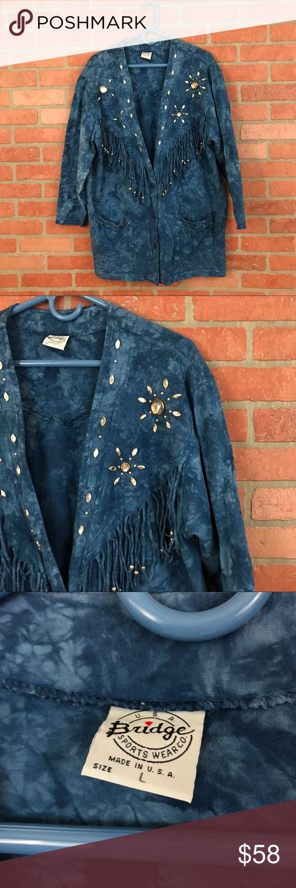 """Vintage 80's/90's Cardigan tie dye fringe L, 228 This amazing blue tie dye knit cardigan feels like it's made of t-shirt fabric and has the best fringe and embellishments! It's bedazzled down the front and has beaded fringe on the back on a v-shape.  This was made in the USA and is vintage from the late 80's early 90's.  In good condition with a couple beads missing.  It's a size L and measures 250 flat across the bust and 31"""" long. Vintage Sweaters Cardigans"""