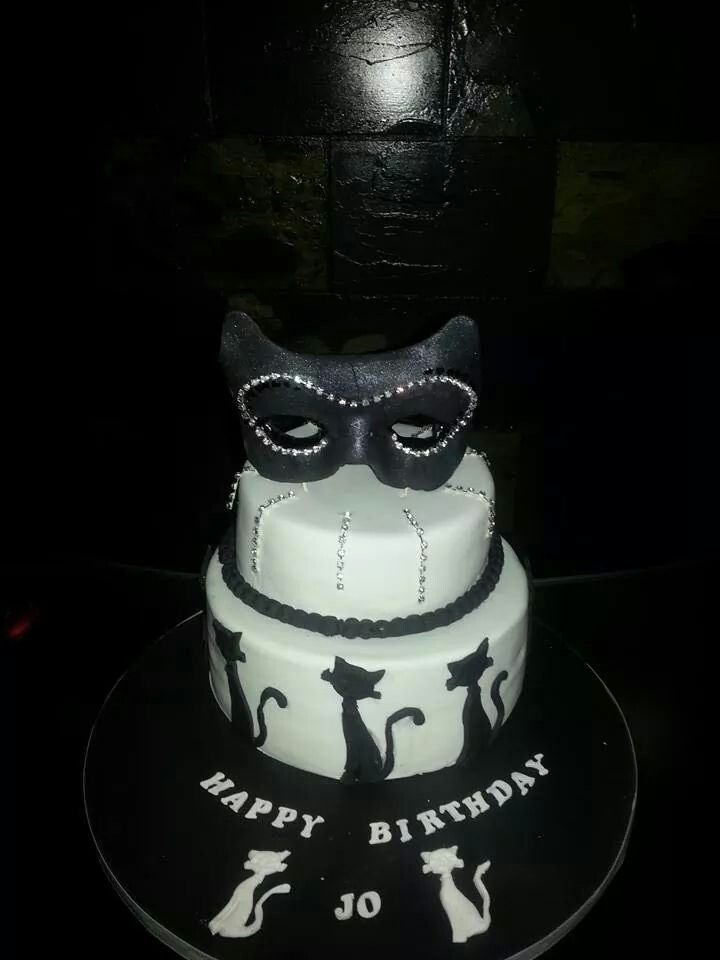 A chocolate jaffa mud cake for a black and white masquerade 40th Celebration with a handmade mask on top!