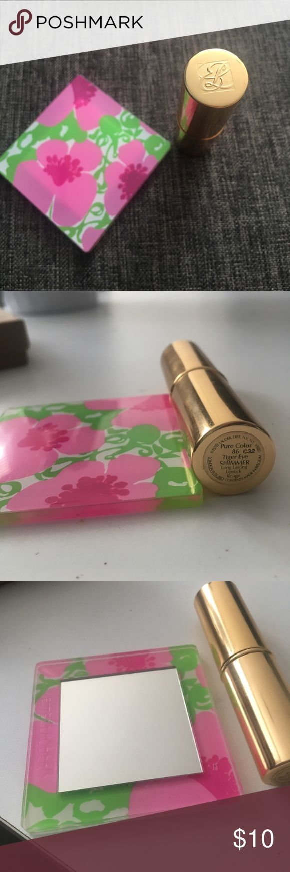 Estée Lauder pure color lipstick Pure color shimmer lipstick! Color name is Tiger Eye Shimmer- Gives your lips a shiny glow. Bought in the wrong color - have only tried it on once and it has been cleaned/disinfected 😊 Lilly Pulitzer style travel mirror included! Offers welcome😊 Estee Lauder Makeup Lipstick