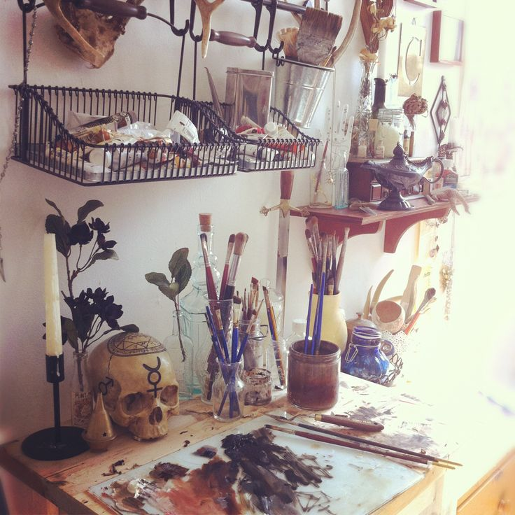 art studio - this artist has put the Ikea provincial kitchen rail to use holding baskets to store all their bits and pieces.