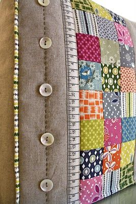Check out this gorgeous sewing machine cover. Love the quilting, buttons, piping and embroidered stitch details.