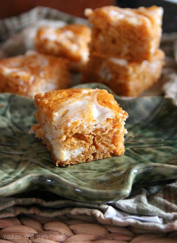 Pumpkin cream cheese squares      1 (8 oz) block 1/3 less fat cream cheese      3/4 cup powdered sugar      1 Tbsp water      1 (16 oz) package Angel Food Cake Mix      1 (15 oz) can pumpkin      3/4 cup water      1/2 tsp Pumpkin Pie Spice      1/2 tsp Cinnamon