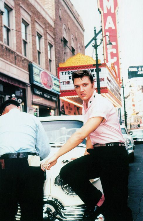 Elvis Presley outside Jim's Barber Shop on Main Street in Memphis, 1956