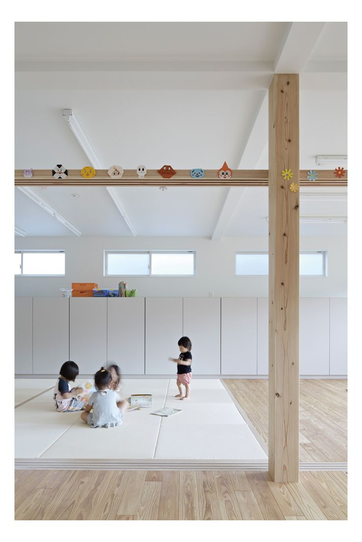 Day nursery in TAKEO / concealed joinery, play mats, exposed beam + columns