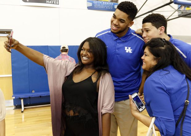 4.11.15.  Karl-Anthony Towns, top left, and Devin Booker take a selfie with Karl-Anthony's girlfriend, India Gentry, and his mother, Jacqueline Cruz-Towns, after the players announced their intent to place their names in the NBA draft.  AP photo/James Crisp.