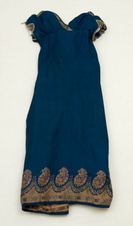 c. 1815 Snowshill Wade Costume Collection, Gloucestershire (Accredited Museum). Summary description  Dress - A woman's silk dress dating from c1815. Fabric - Fine royal blue silk twill, with woven border of buta and a band of stylised flowers in red, blue, green, yellow, and pale pink.