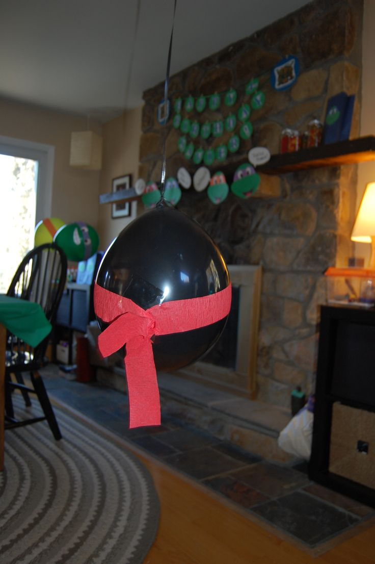 """A TMNT party wouldn't be complete without Shredder's ninjas!  Pinner hung black balloons with red ninja """"masks"""" from up high. Simple and very entertaining!"""