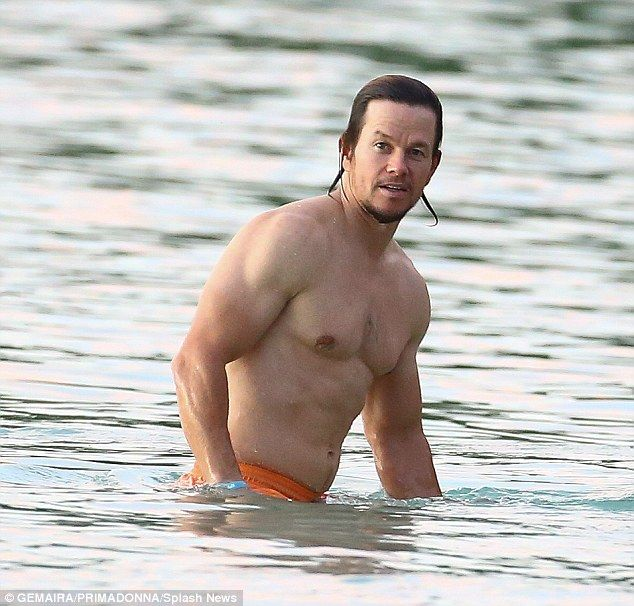 Sexy and shirtless! Mark Wahlberg was spotted showing off his muscles on the beach in Barbados