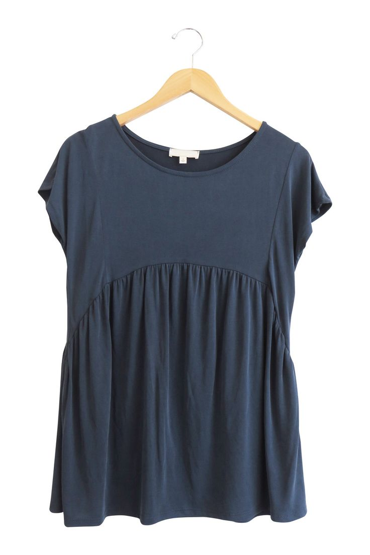 "Navy Babydoll Top Loose Fit Short Sleeve Extremely Soft Material Fits True to Size Also Available in Mauve Model is 5'7"" and Wearing a Small"