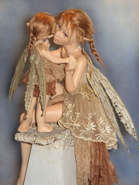 Autumn Fairy Tale  A fairy mother and her daughter.  Sculpted from La Doll clay.  Hair from viscose.  Wings from organza.  Clothes from silk and lace.   She is painted with Fairy Skin paint, Sun Kissed.    Autumn Fairy Tale is in Russia.
