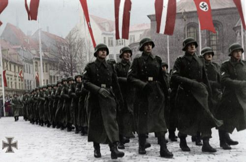 "The Waffen-SS Legion ""Latvija"" march through Riga in celebration of Latvian Independence Day, 1943. Upon its founding in 1943, the Latvian Legion witnessed an astounding 87,550 volunteers, following what was known as the ""Year of Terror"" (1940-41); Latvia's occupation by the USSR. Stalin terrorized the nation, ordering many thousands of Latvians to be shipped to death camps. Today, annual celebrations are held in Riga to honor the Latvian SS and their fight for freedom against Soviet…"