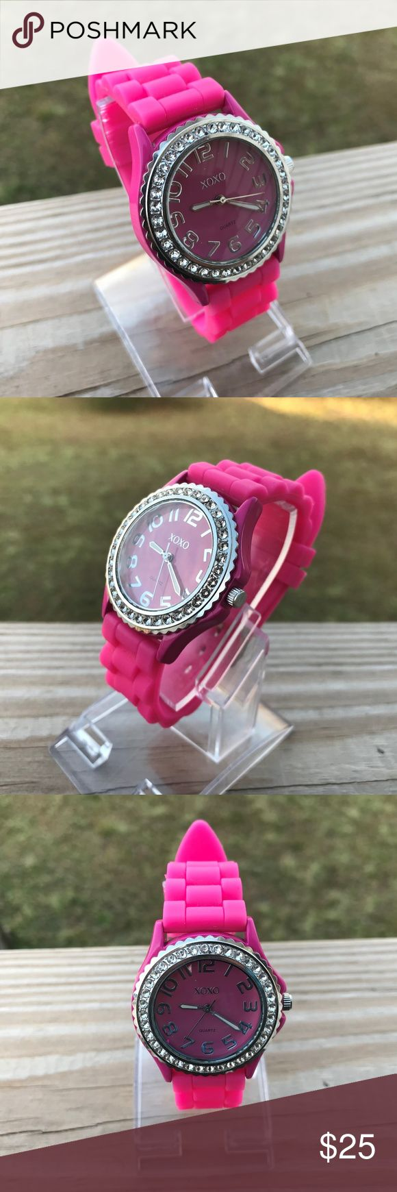 XOXO Ladies Watch Pink Silicon Rubber Band Analog XOXO Ladies Watch Pink Silicon Rubber Band Women Fancy Analog Wrist Watch  Band: XOXO  Color: Pink + Silver  Size: belt ( adjustable )  Pre-owned: never used, look like new. XOXO Accessories Watches