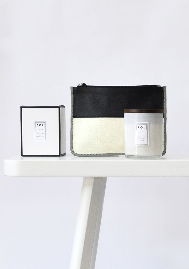 Colourblock clutch and scented candles.