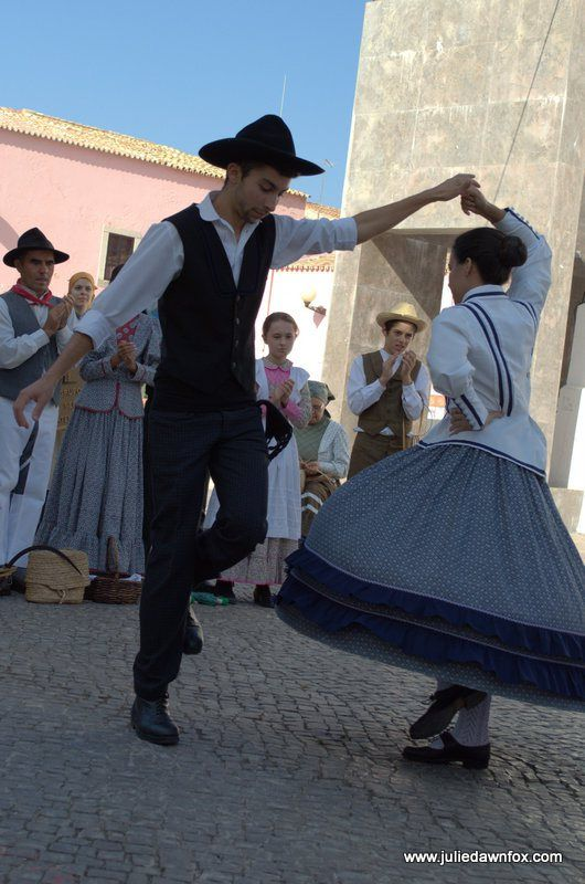 Spinning skirts, traditional costumes and folk dancing in Loulé, Algarve, Portugal.
