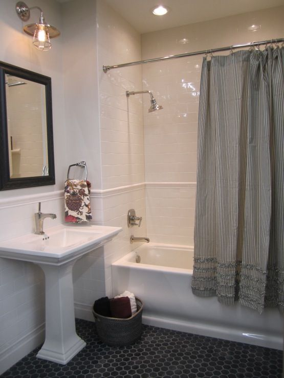 source: The Tile Shop    Kirsty Froelich - ceramic tile from the Tile Shop Pottery Barn gray ruffle shower curtain and towels