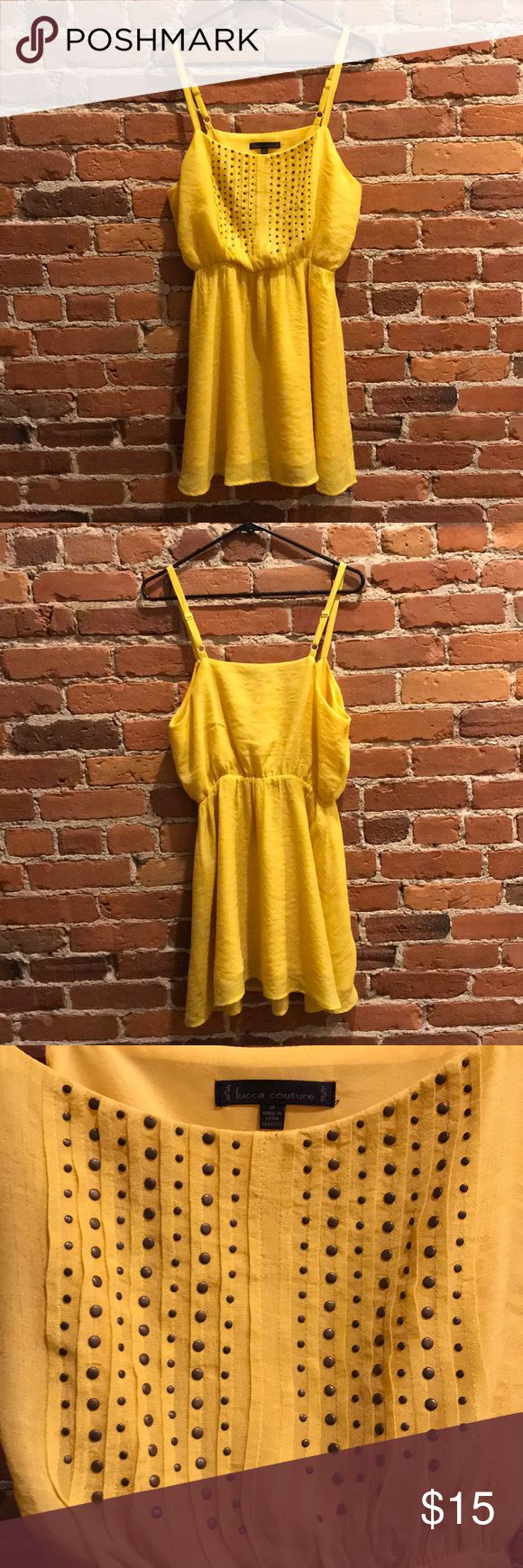 Fun yellow/golden dress for a night out! This yellow/golden dress has adjustable straps and an elastic waistband. It features bronze-colored beading on the front, and has a flowy, breezy bottom. The yellow has a nice subtle shine. Perfect summer dress for a fun night out!   Originally purchased from Urban Outfitters. In good condition. Lucca Couture Dresses Mini