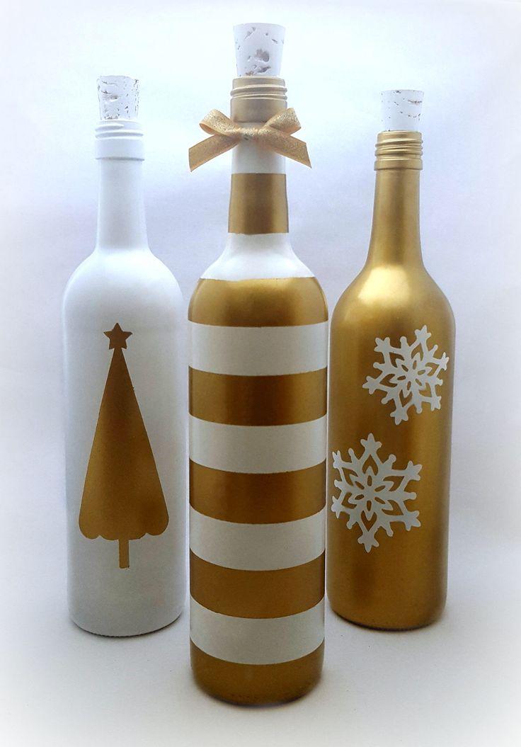 Christmas Wine Bottles / Gold and White Hand Painted Bottles / Winter Holiday Wine Bottles / Snowflakes and Christmas Tree Wine Bottles by micandmak on Etsy https://www.etsy.com/listing/557120290/christmas-wine-bottles-gold-and-white