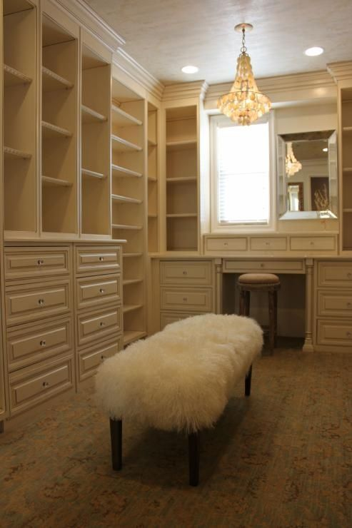 white built in shelves and built in vanity. walk in closet ideas ...minus  the bench
