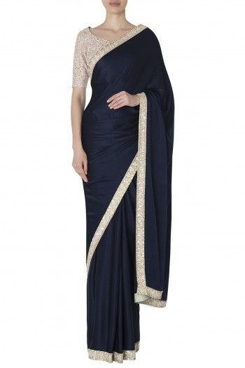 e641b2946af Manish Malhotra Featuring a navy blue saree in satin chiffon base with  pearls and sequins embroidered borders. It is paired with a multi-coloured  sequins ...