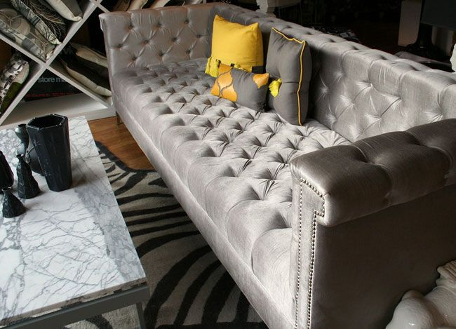 A Masculine Spin On Hollywood Regency Decor Gray Perpendicular Couch Faux Zebra Rug And Diamond Shelving In The Back