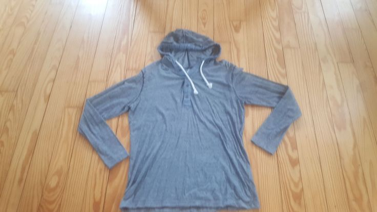 American Rag men's half button cotton long sleeve hoodie, size large .Pre-owned and still in excellent condition from a clean and smoke-free environment.