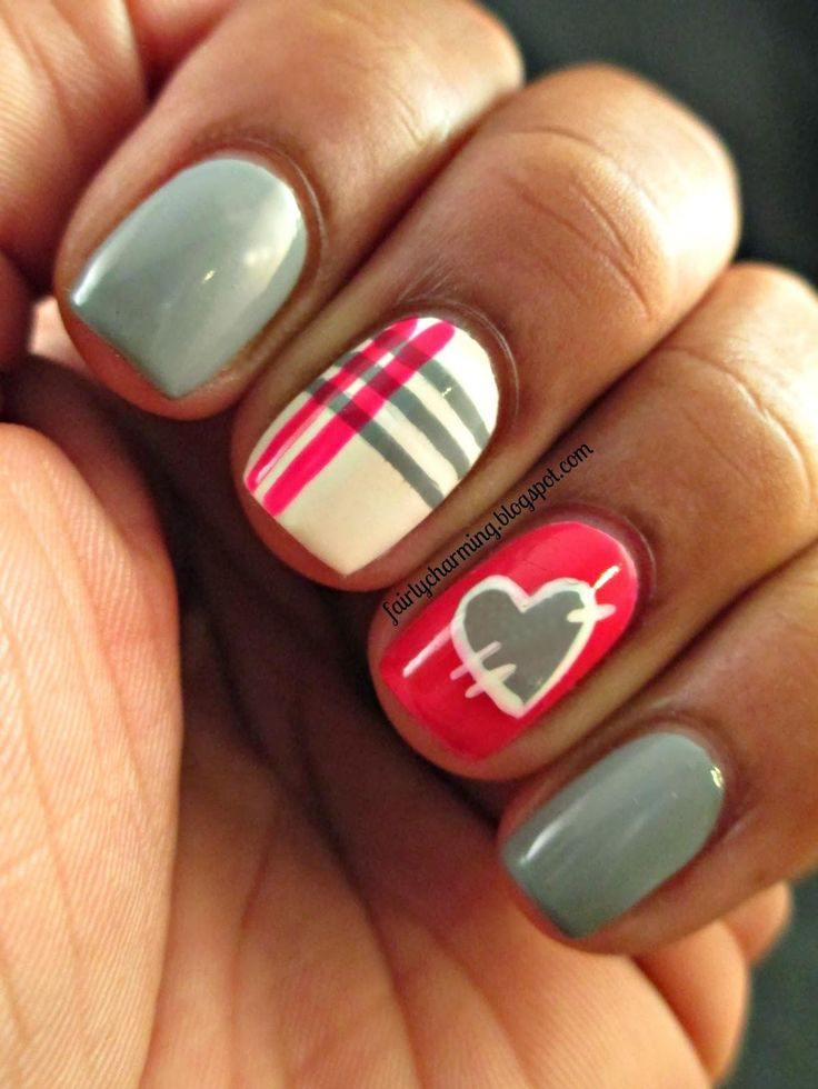 This patchwork and plaid nail art by Fairly Charming makes for a playful Valentine's Day look. She uses gray, white, and fuchsia polishes, but a combo of pink shades would be a pretty alternative. Paint the heart with the bottle's brush, and then create the outline and stripes with a small nail art brush.