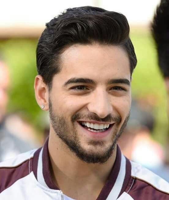 Maluma is a 20 year old boy singer who looks like a man....finally!