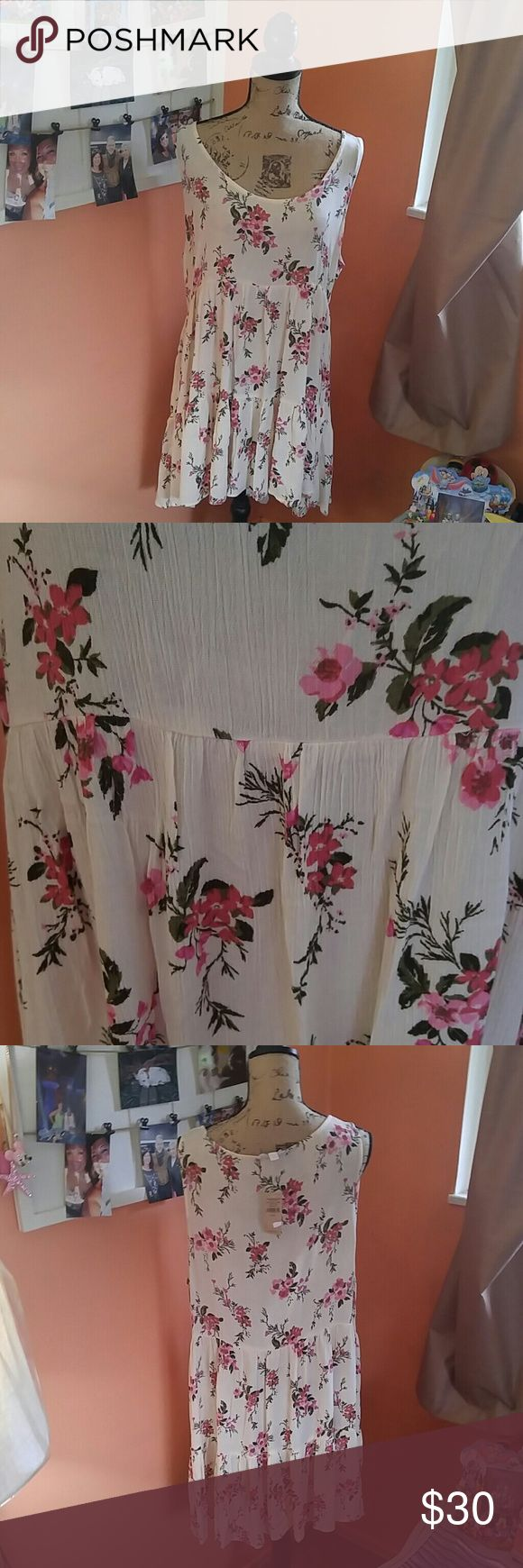 American Eagle boho style dress This American Eagle size XL boho style dress is absolutely gorgeous. It has pink floral design and off white cream color background ruffled bottom will need to wear a cami or a tank top underneath it. This is new with tags it has never been worn so ready for that summer vacation or a night out on the town.. Up with some beautiful boho sandals and you're all set to go be considerate when making offers and I do not trade American Eagle Outfitters Dresses